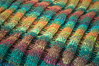 Knit ridges and dropped stitches.