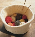 This is the original knitting basket image from the Martha Stewart Living website. It is made from a deconstructed felted wool sweater. <em>Image from Martha Stewart Living</em>.
