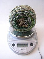 Weighing in.  My previous measurements showed that I used 67g for the increase sections of my Clapotis.  If I start decreasing now I should have just enough yarn, with very little leftovers.