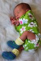 These wee booties are still a little big for tiny preemie Serena.