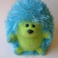 A lime green felted hedgehog made by Alice .