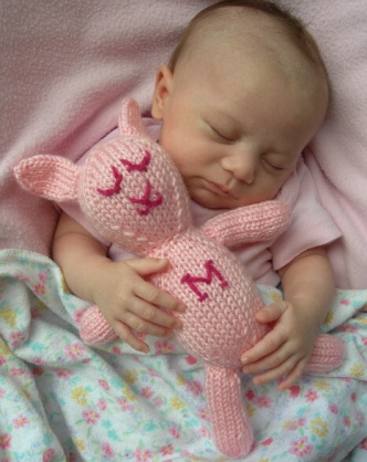Sleeping her her bunny stuffed animal!