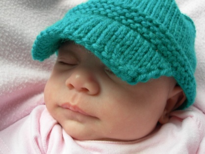 Jojo modeling her new baby sized Kiddy Cadet hat.