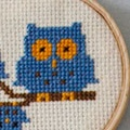 Anna has recently branched out into cross stitch patterns.